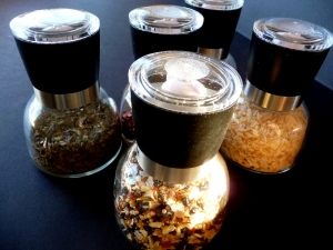 Inexpensive glass spice grinders used for herb mixes